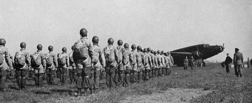 RSI's paratroopersParatrooper of Repubblica Sociale Italiana (RSI), the Italian Fascist Republic founded by Benito Mussolini on 23 september 1943, waiting for the embark on board of a Savoia-Marchetti S.82 transport aircraft, Vergiate airfield, Varese, Northern Italy, 1944.