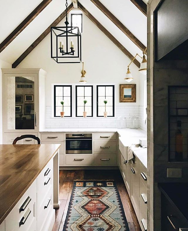On the blog today we rounded up some gallery wall art picks, which has nothing to do with this photo, but I couldn't resist this kitchen! The lights, the windows -- pretty much everything!! @johnstoffer