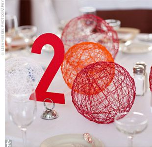 The couple created non-floral centerpieces by making string balls out of colorful yarn and fabric stiffener.