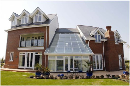 This Cheshire home features a large glass atrium incorporating Pilkington Activ™, benefitting from self-cleaning properties