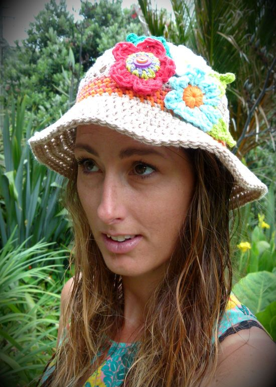 100% cotton women's sun hat in natural sand with 3 bright multi-coloured flowers, leaves & accent stripes. Handmade in Aotearoa NZ. www.facebook.com/thelittlebeenz www.etsy.com/shop/thelittlebeenz