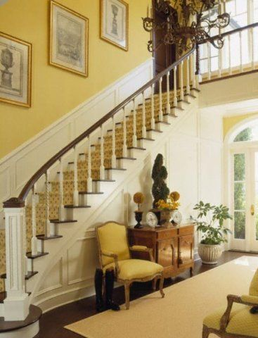What a magnificent entry hall!  Love the yellow walls and crisp white woodwork!