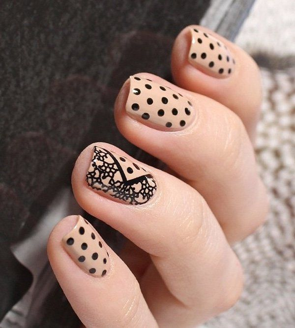 Nude polish in polka dot and flower nail art design. Give statement to your nails by painting on flower and polka dot details in black polish.