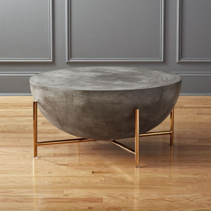 Shop darbuka brass coffee table.   Designed by Mermelada Estudio, handmade coffee table resounds with global style.  Inspired by North African drums, substantial surface combines cement, stone powder, granite and marble powder to a natural stone effect.