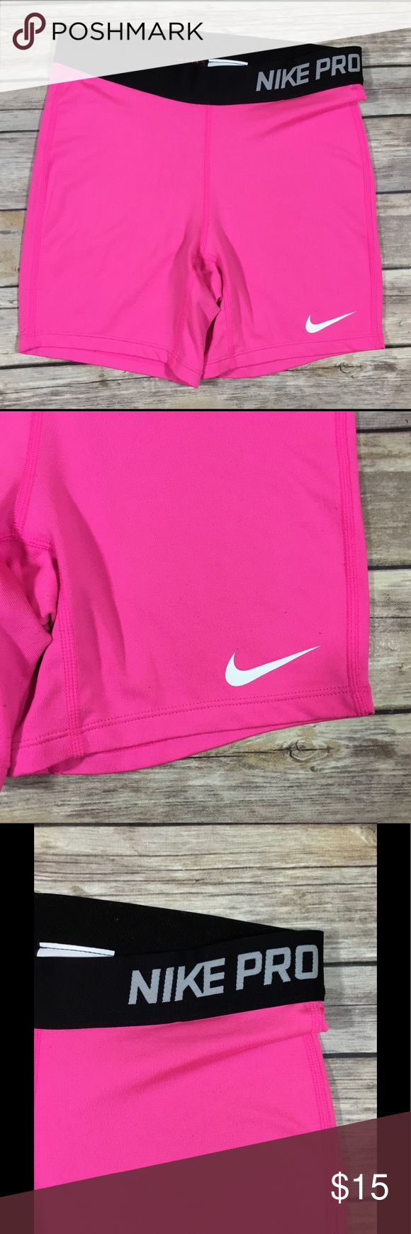 "Nike Pro Girls Dri Fit Pink Compression Shorts 168 Nike Pro Girls Dri Fit Pink Compression Shorts. GUC with minor wear, as pictured. Size XL. 92% Polyester and 8% Spandex.  Waist - 24"" Hips - 26"" Rise - 7.5"" Inseam - 5"" Nike Bottoms Shorts"