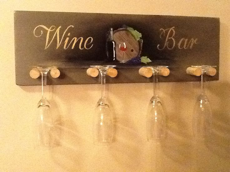 Custom Hand Painted Wine glass rack with corks for hangers make a unique gift for any home for only $34.99 see this and many more unique gift ideas at www.apartworksanddesign.etsy.com