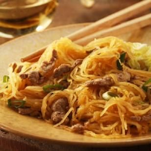 Wondering what to do with some Spaghetti Squash? Try this recipe for Spaghetti Squash & Pork Stir-Fry from @EatingWell.