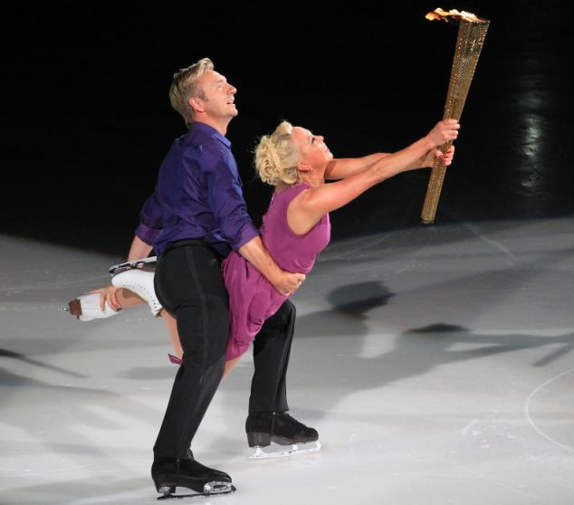 Torvill and Dean skate with the Olympic torch