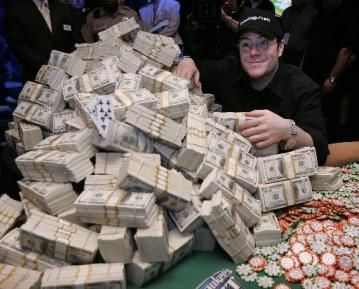 Winner of the 2006 World Series of Poker, Jamie Gold, of Malibu, with his $12 million winnings of cash and poker chips.