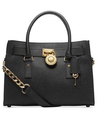 Soft leather and luxe hardware grace this gorgeous design from Michael  Michael Kors. Bold chain detailing and a prominent signature lock charm at  front ... 956e5954844