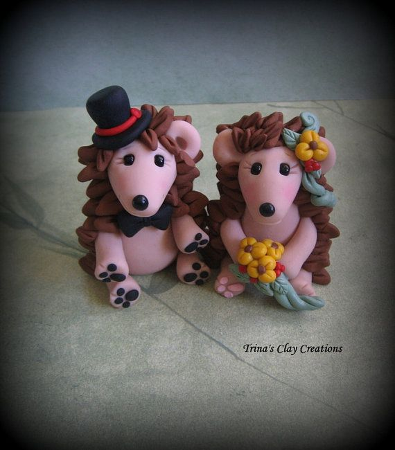Made by me, entirely of polymer clay, these darling Hedgehogs are ready to celebrate a very special wedding! Hes wearing a tiny top hat with