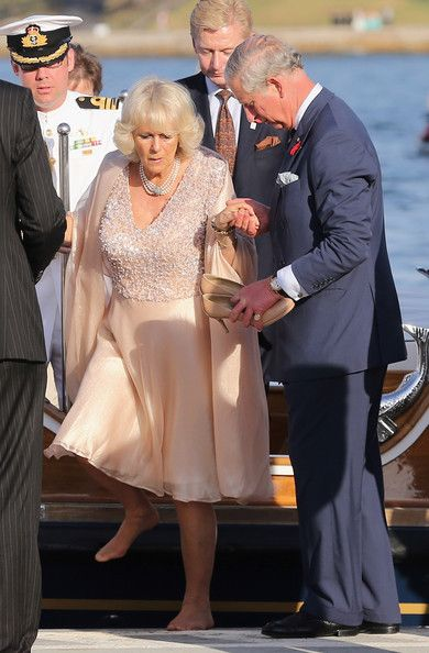 Camilla Parker Bowles - note Charles has her shoes.....REALLY!!!!