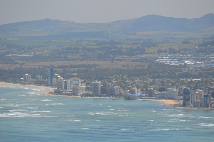 Strand Beach Road's nearly 5 km stretch as seen from the Hottentots Holland mountain range edging the eastern side of False Bay, Cape Town. Most of the Platinum Mile, Central Strand and the Golden Mile is visible on the photo - visible blocks from the right - Wavecrest, 33On Sea, Oceanview (tallest block in the Platinum Mile) and Kuriaki. On central Beach Road, Odeon Towers, Helderberg, Rialto Bay, Metropole Plaze, Grasso,Mont Carlo, Blinkwater, and Hibernian Towers is visible. #strand