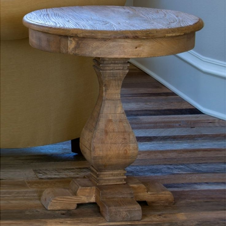 "Another reclaimed pine piece that focuses on the grain and gift of the wood. Round top with decorative apron; pedestal style with a cross base. A bit over twenty five inches tall. brbrUA HREF=""..."