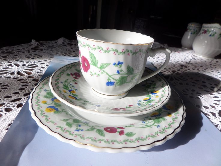 Trade Winds trio, cup, saucer and plate, pansies and poppies, swirl shaped body, English pottery, gilded edges, flowers borders, 1970s items by MaddisonsRainbow on Etsy