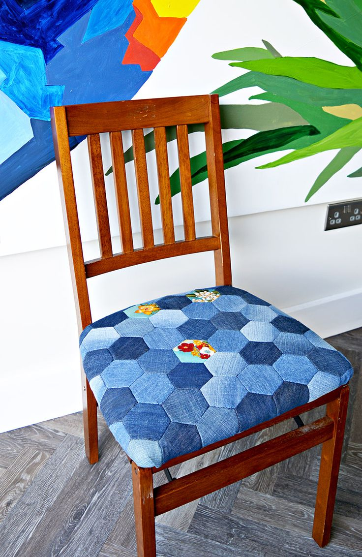 Denim patchwork chair made from upcycled old jeans using hand sewn denim hexagons. Full tutorial.