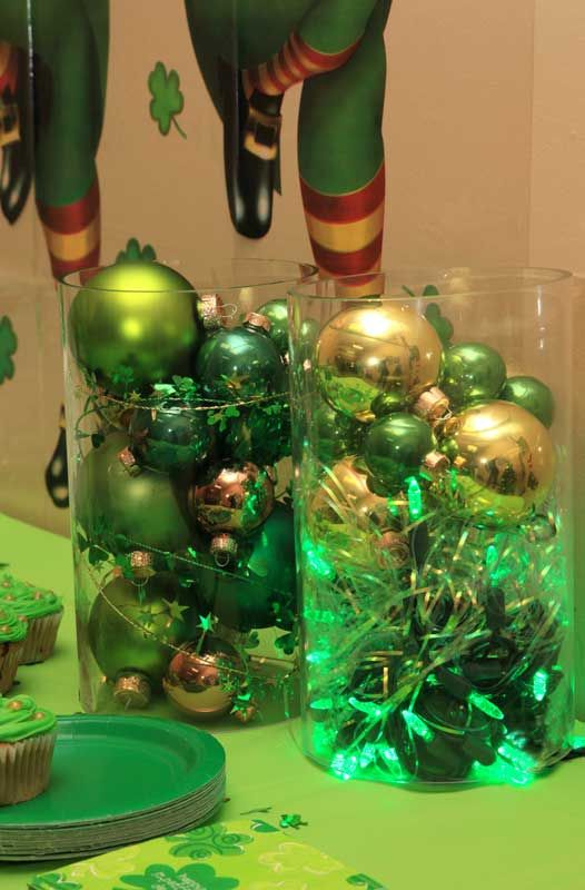 St Patrick's Day decorations idea: green LED lights and glass ornaments in glass cylinders we have been waiting to use for years