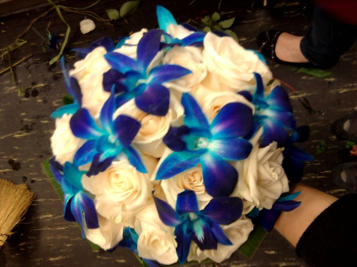 Ivory rose and blue orchid bridal bouquet