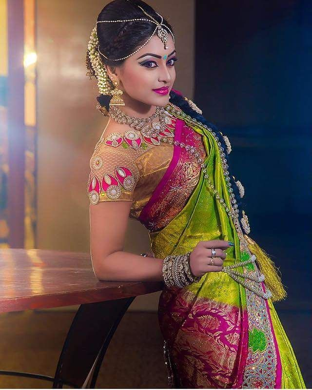 South Indian bride. Diamond Indian bridal jewelry.Temple jewelry. Jhumkis.Green silk kanchipuram sari with contrast pink blouse.braid with fresh jasmine flowers. Tamil bride. Telugu bride. Kannada bride. Hindu bride. Malayalee bride.Kerala bride.South Indian wedding.