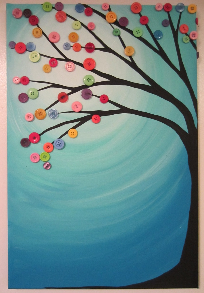 paint and buttons on a canvas
