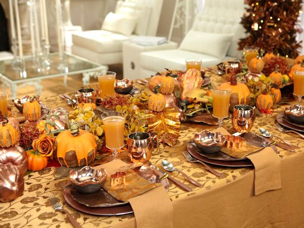 Sandra Lee Tablescapes  Festive Thanksgiving  Fake gourds, flowerpot molds, fall leaves, branches and lots of copper (from the charger plates to the three-tiered dessert stand) blend together in Sandra's turkey-day tablescape to create an earthy, metallic decor.