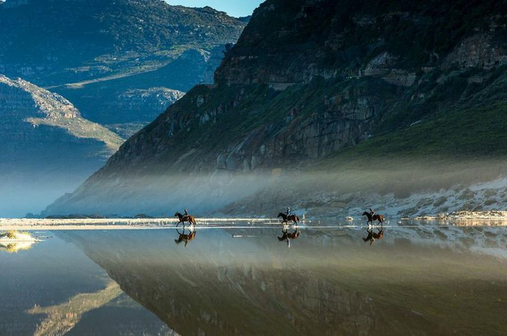 Horse-riding along Noordhoek Beach in the Western Cape. Photograph by by African Pixels.