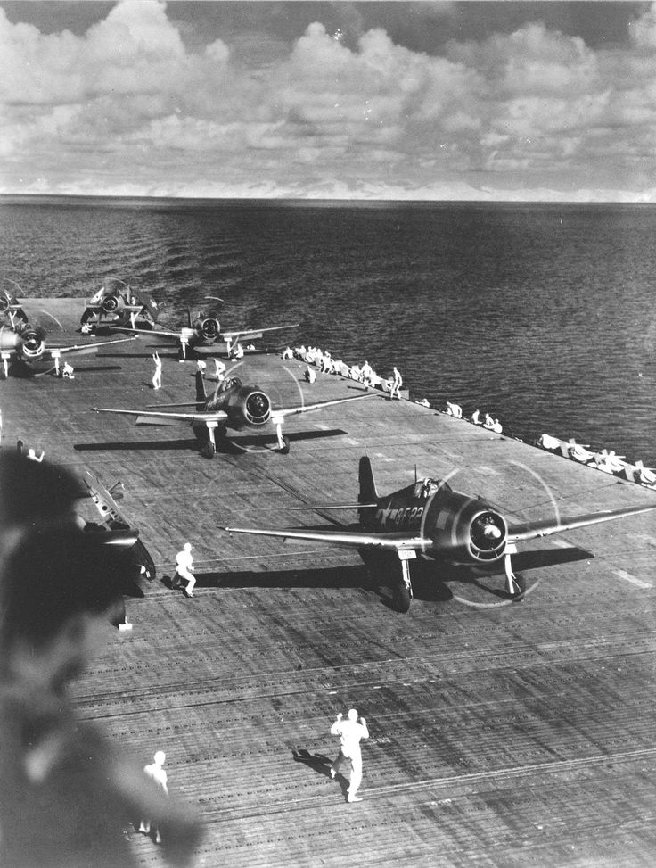 F6F Hellcat aircraft of Fighting Squadron 8 warm up on USS Intrepid's flight deck, 1943, photo 2 of 2; probably during stateside shakedown training