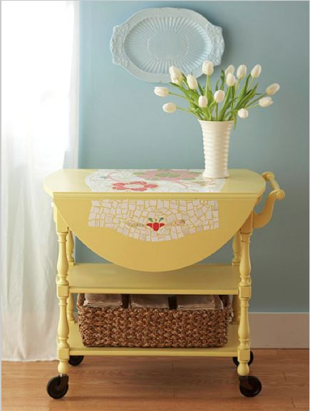 Renew an old piece of furniture - Sand, prime, and paint the cart to make it new again. When dry, use a pencil to sketch a simple design on the cart. Cut scrapbooking paper into small pieces, then use decoupage glue to secure the pieces over the design. Cover the finished motif with two more coats of decoupage glue.