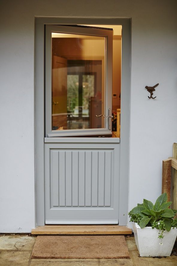 Factory-finished panelled and half-glazed timber stable door lets the light and fresh air in without letting the dog out.