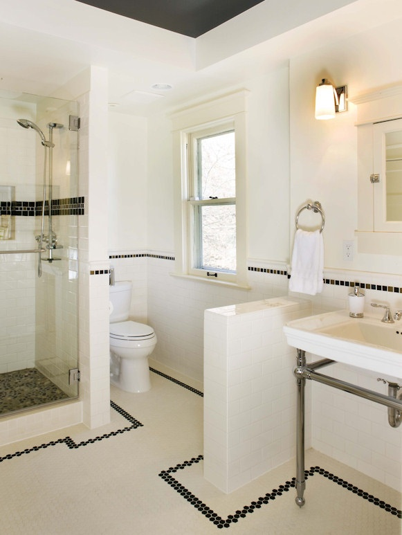 Another classic bungalow bathroom...like the black tile borders...