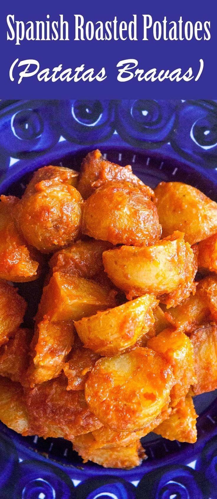 Spanish tapas appetizer known as patatas bravas, or angry potatoes - roasted potatoes tossed with a spicy, smoky tomato sauce.#potatoes #patatasbravas #potatorecipes