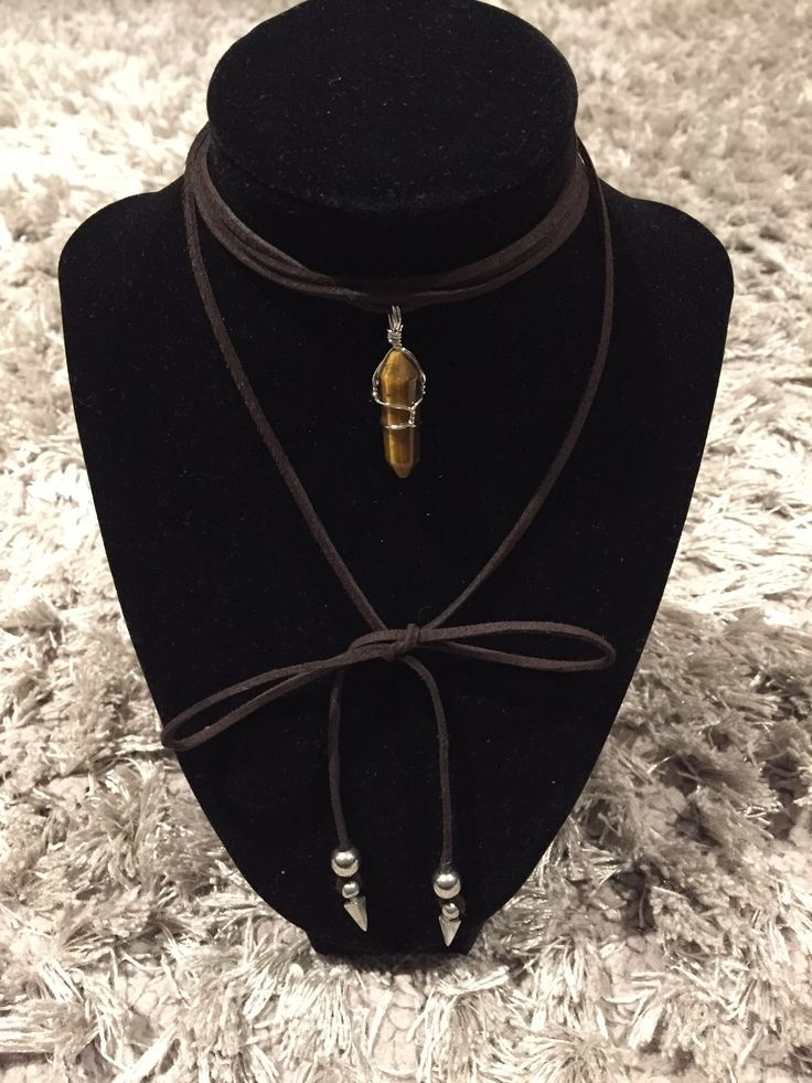 Brown suede wrap choker with pendant and metal decorative ends. #wrapchoker #choker #necklace #thaddesign
