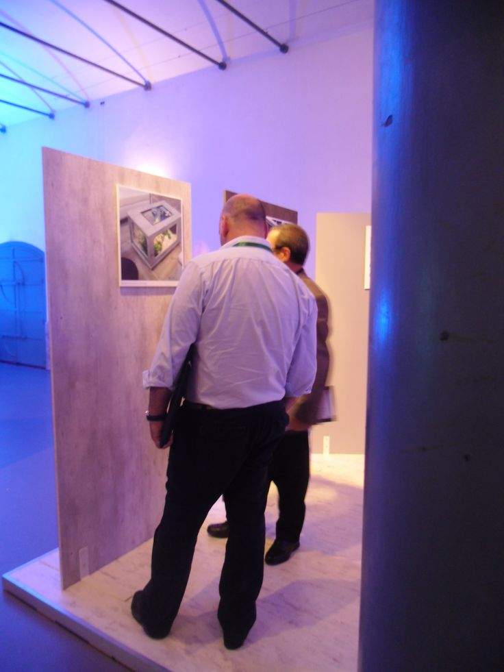 Visitors admiring our decorative panels at innovation exhibition.