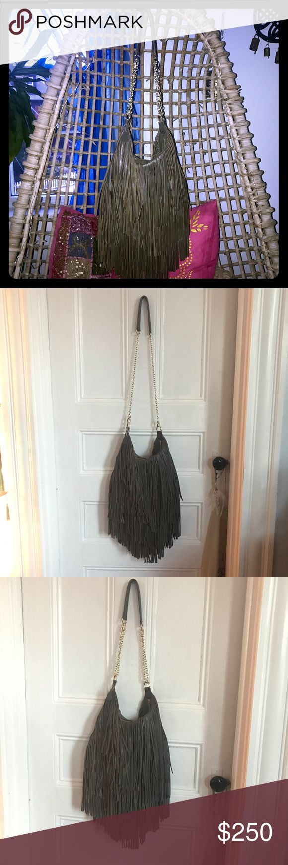 """Amazing NWOT hobo fringe bag Bohemian-perfect bag. This is my friend's 100% leather hobo bag and she has never used it.  Immaculate inside and out (inside flipped out to show).  A+ festival fringes with no crumpling.  Awesome olive green/grey goes with everything. Approx 14""""x14"""" with a 39"""" adjustable or removable/changeable strap. Wear crossbody or nah. Pic #7 shows short, #8 shows long. Purchased at Lost and Found boutique in Hollywood for over $900. Anthropologie sold the same bag called…"""