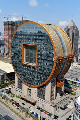 C.Y. Lee, the Taiwanese architect who built Taipei 101, one of the world's tallest buildings, also made this—one of the world's ugliest. The 25-floor office block in Shenyang, China, takes inspiration from ancient Chinese coins—circles with square cutouts in the middle. Abu Dhabi's Aldar building—the other coin—looks sleek