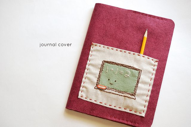 Use Felt and embroidery to cover composition notebook. I like the pocket.