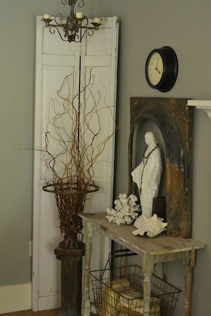 Love the simplicity of this chandelier paired with branches and distressed table.