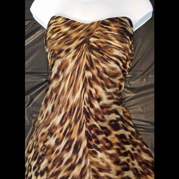 Laundry by Shelli Segal Animal Print Long Dress A tight front twist shapes the sweetheart bodice of this strapless slight A- Line full length fully lined silk dress. Laundry by Shelli Segal Dresses