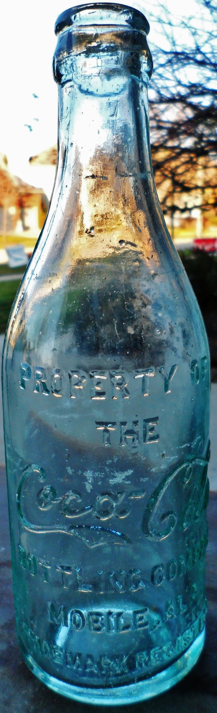 Extremley Rare Clear Straight Sided Embossed Script Coca Cola Bottle from Mobile Alabama, circa early 1900's