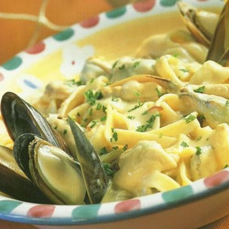 CREAMY MUSSEL PASTA IN WHITE WINE GARLIC SAUCE Recipe Main Dishes with mussels, white wine, garlic, spring onions, fresh parsley, chives, cream, salt and ground black pepper, linguini
