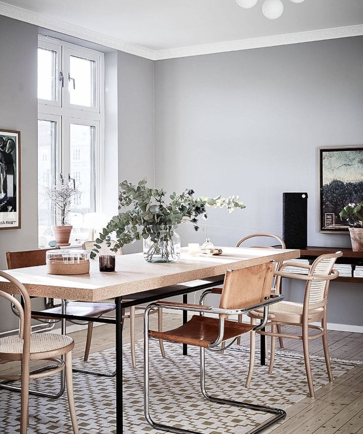 i like the warm details of the wooden and leather furniture and accessories against the cool grey walls the cork dining table with a mix of chairs in - Cork Dining Room Design