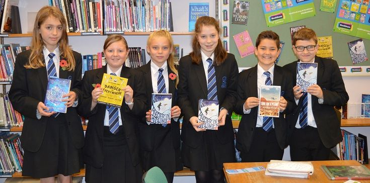 """QEGS students get reading with Bookbuzz http://www.cumbriacrack.com/wp-content/uploads/2017/11/171109-Bookbuzz.jpg Queen Elizabeth Grammar School's year 7 students have all been given a new book in their first term at the school, as part of """"Bookbuzz"""", a national initiative to encourage reading for pleasure    http://www.cumbriacrack.com/2017/11/16/qegs-students-get-reading-bookbuzz/"""