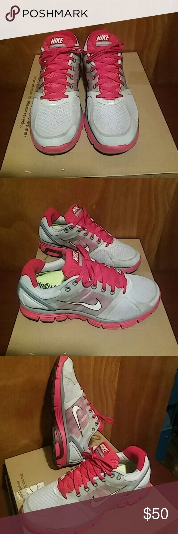 NIKE LUNAR GLIDE 2 Pre owned, clean and well kept sneakers. Women Size 9 US. Only worn a couple of times. Small scuff on right sneaker near inner heel as seen on pic #5. Fuschia and grey with reflectors on back heels and top near shoestrings. Nike Shoes Athletic Shoes