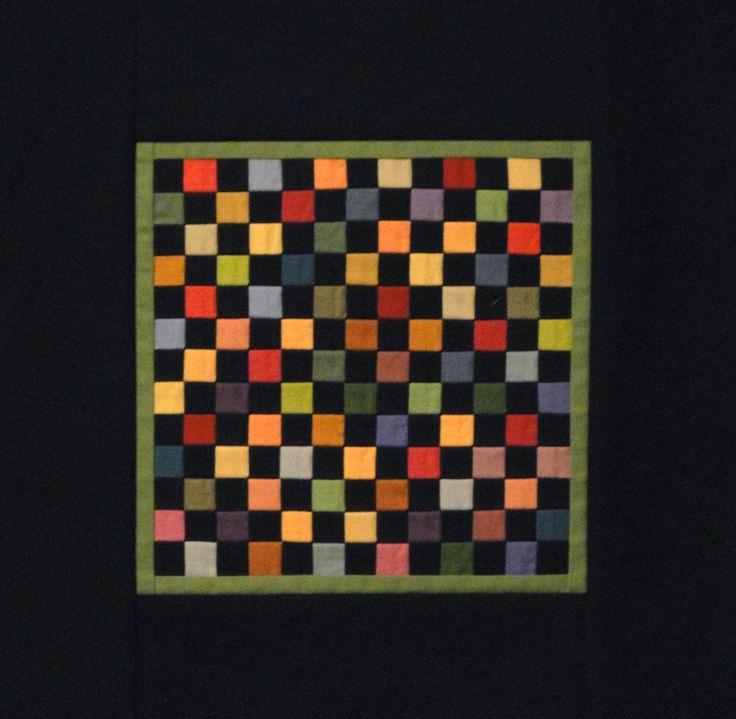 Amish Scrap Miniature Quilt - how the black sets off the rich colours