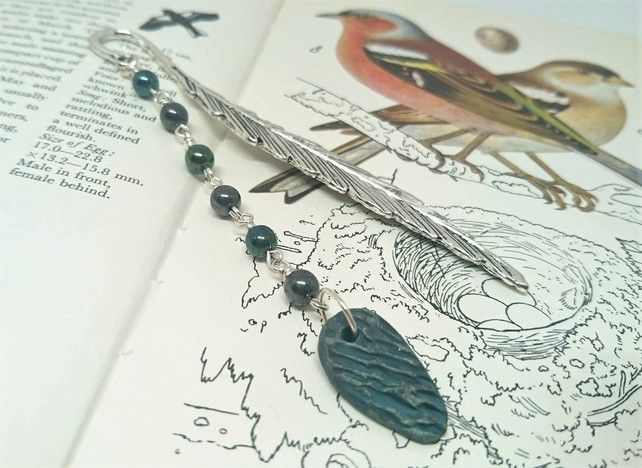 Feather bookmark with ceramic charm and metallic look beads £7.50