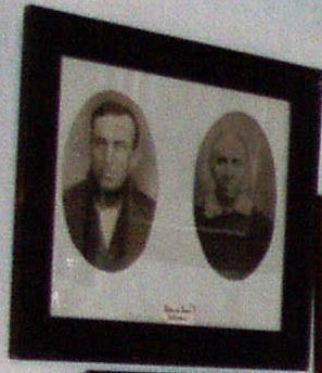 Framed portraits of John and Jane Gilmore. They worked for the Maleys in the 1880s.