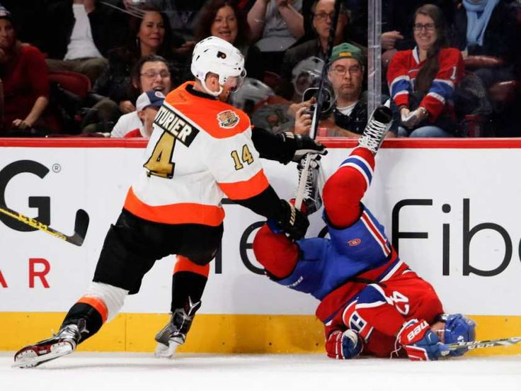 Canadiens' Alexander Radulov gets turned upside down by Philadelphia Flyers centre Sean Couturier during NHL action at the Bell Centre in Montreal on Saturday, Nov. 5, 2016.