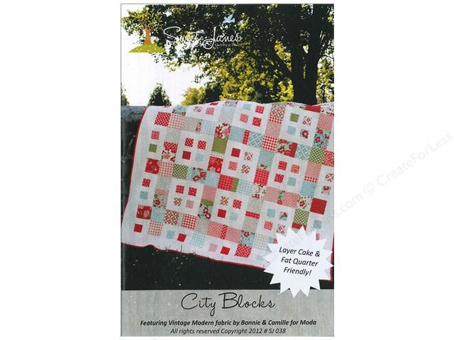 Sweet Jane's Designs City Blocks Pattern. In a certain way this design looks like an aerial map of a city with 4 square buildings per square block and the city blocks surrounded by pieced streets, with the streets' crosswalks at the center of each side of the city block. Layer Cake and Fat Quarter friendly. Choose from Baby size 39 x 39 inch or Lap size 68 x 68 inch. Includes instructions and diagrams.