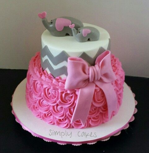 Pink rosettes and gray chevron with elephants baby shower cake. Www.facebook.com/simplycakes.brittneyshiley Www.simply-cakes.com