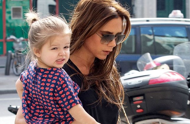 Victoria Beckham and her daughter Harper Seven are seen arriving at the 'BONTON' store on May 4, 2013 in Paris, France. | Music's Hottest Moms